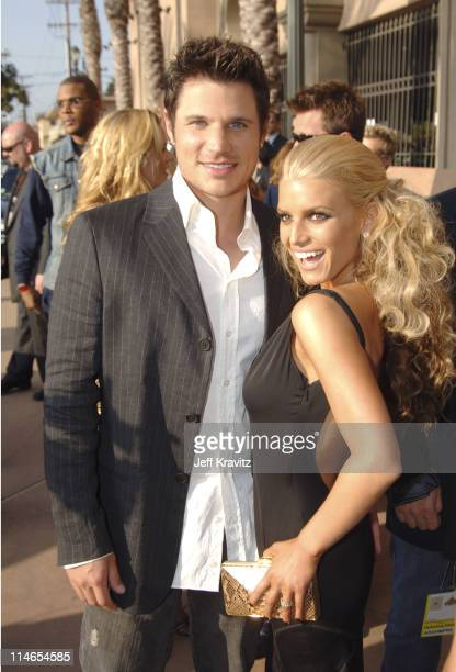 Nick Lachey and Jessica Simpson during 2005 MTV Movie Awards Red Carpet at Shrine Auditorium in Los Angeles California United States