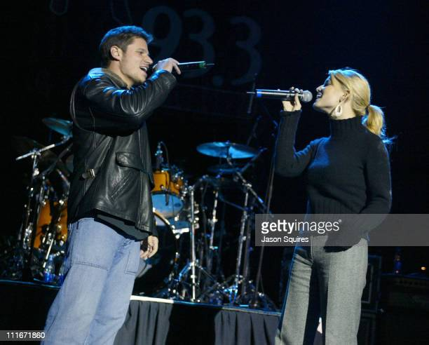 Nick Lachey and Jessica Simpson during Jessica Simpson and Nick Lachey host Mix 933's Jingle Jam V in Kanas City on December 2 2003 at Uptown Theatre...