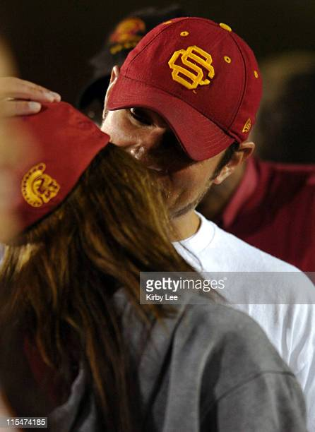 Nick Lachey and Vanessa Minnillo kiss on the sidelines during USC football game against Notre Dame at the Los Angeles Memorial Coliseum in Los...