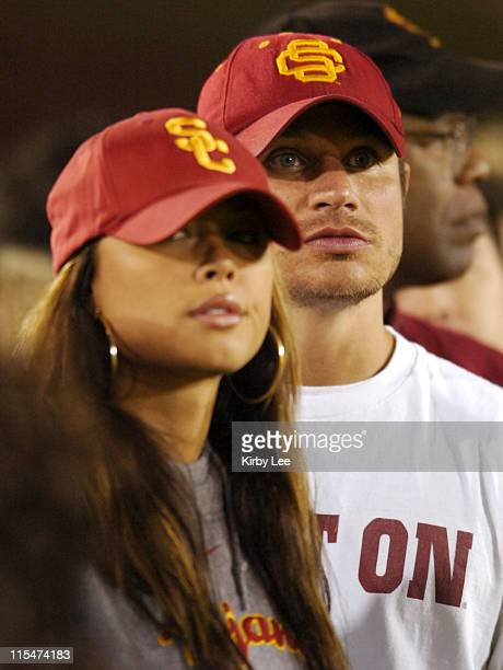 Nick Lachey and Vanessa Minnillo watch from the sidelines during USC football game against Notre Dame at the Los Angeles Memorial Coliseum in Los...