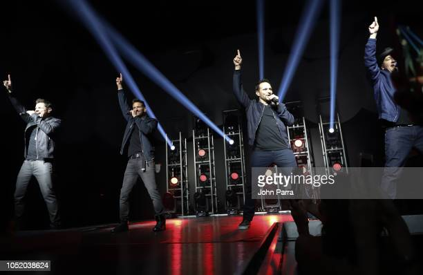 Nick Lachey Jeff Timmons Drew Lachey and Justin Jeffre of 98 Degrees perform at Fountainbleau Miami Beach on October 12 2018 in Miami Beach Florida