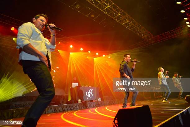 Nick Lachey, Jeff Timmons, Drew Lachey and Justin Jeffre of 98 Degrees perform on stage at Seminole Casino Coconut Creek on February 28, 2020 in...