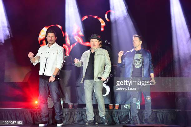 Nick Lachey, Justin Jeffre and Jeff Timmons of 98 Degrees perform on stage at Seminole Casino Coconut Creek on February 28, 2020 in Coconut Creek,...