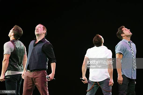 Nick Lachey Justin Jeffre Drew Lachey and Jeff Timmons of 98 Degrees perform onstage during The Package Tour held at Staples Center on July 5 2013 in...