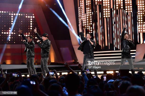 Nick Lachey Justin Jeffre Jeff Timmons and Drew Lachey of 98 Degrees performs at the 2018 iHeartRADIO MuchMusic Video Awards at MuchMusic HQ on...