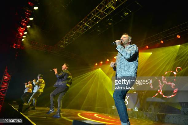 Nick Lachey, Justin Jeffre, Jeff Timmons and Drew Lachey of 98 Degrees perform on stage at Seminole Casino Coconut Creek on February 28, 2020 in...