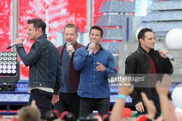 Nick Lachey Justin Jeffre Jeff Timmons and Drew Lachey of 98 Degrees perform during the taping of Disney Parks Magical Christmas Celebration at Walt...
