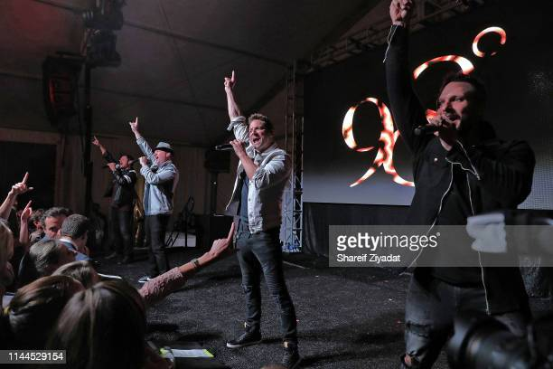 Nick Lachey Justin Jeffre Jeff Timmons and Drew Lachey of the group 98 Degrees perform during Under The Stars 2019 at Riverside Yacht Club on May 17...