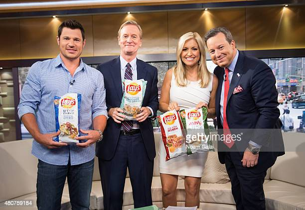 Nick Lachey Steve Doocy Ainsley Earhardt and Ed Henry pose on the set of 'Fox Friends' at FOX Studios on July 15 2015 in New York City