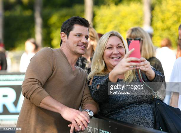 Nick Lachey takes a selfie with a fan at 'Extra' at Universal Studios Hollywood on January 10 2019 in Universal City California