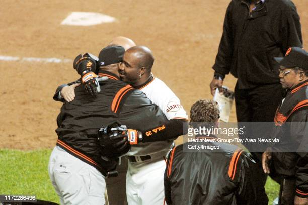 Nick Lammers/staff 4/18/01 Tribune SportsFollowing his historic 500th blast, Barry Bonds hugs Willie McCovey and Willie Mays, two former Giants...