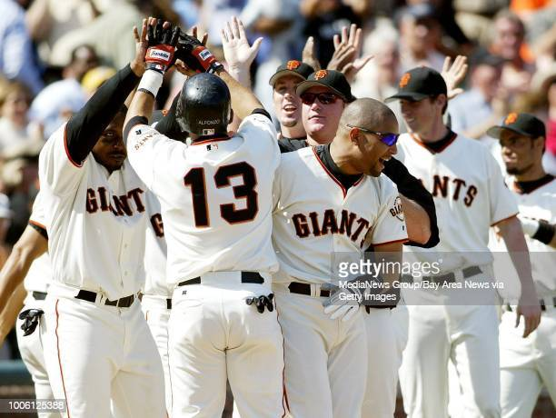 Nick Lammers/staff 9/3/03 Tribune SportsYorvit Torrealba and other Giants rejoice after pinch-runner Eric Young scores the winning run in the...