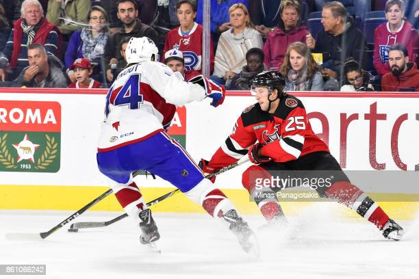 Nick Lappin of the Binghamton Devils skates the puck against Brett Lernout of the Laval Rocket during the AHL game at Place Bell on October 13 2017...