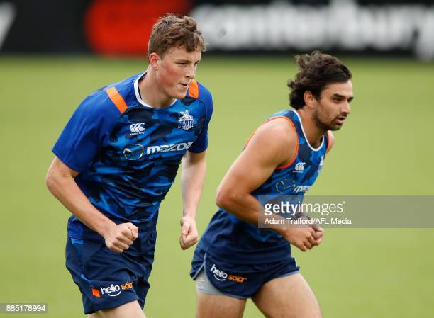 Nick Larkey and Alex Morgan of the Kangaroos run the yoyo test during the North Melbourne Kangaroos training session at Arden St on December 4 2017...