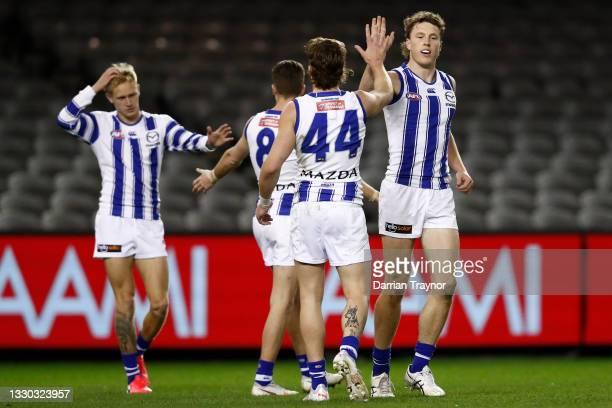 Nick Larkey of the Kangaroos celebrates a goal during the round 19 AFL match between Carlton Blues and North Melbourne Kangaroos s at Marvel Stadium...