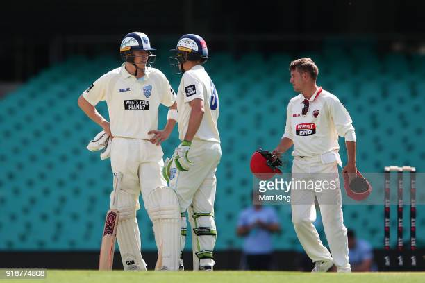 Nick Larkin of the Blues talks to Daniel Hughes of the Blues in between overs during day one of the Sheffield Shield match between New South Wales...