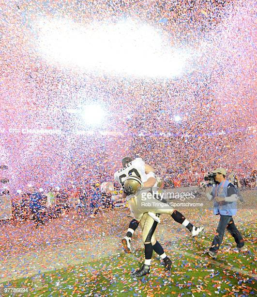 Nick Leckey of the New Orleans Saints celebrates on the field with a teammate after defeating the Indianapolis Colts in Super Bowl XLIV on February 7...