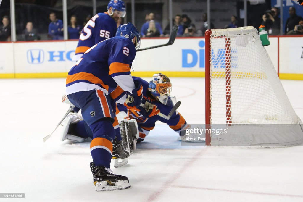 Nick Leddy #2 and Jaroslav Halak #41 of the New York Islanders give up the game winning goal to Matthew Tkachuk #19 of the Calgary Flames in the last few minutes of play in the third peroid during their game at Barclays Center on February 11, 2018 in the Brooklyn borough of New York City.