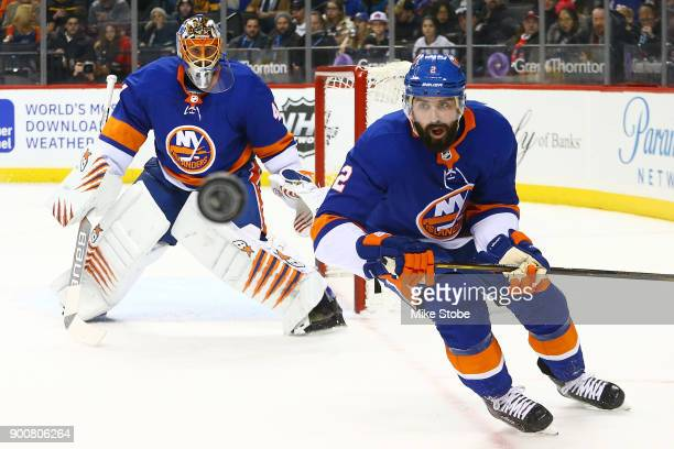 Nick Leddy and Jaroslav Halak of the New York Islanders track a flying puck during the second period against the Boston Bruins at Barclays Center on...