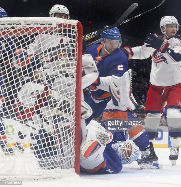 Nick Leddy and Thomas Greiss of the New York Islanders defend the net against the Columbus Blue Jackets during the second period at NYCB Live's...