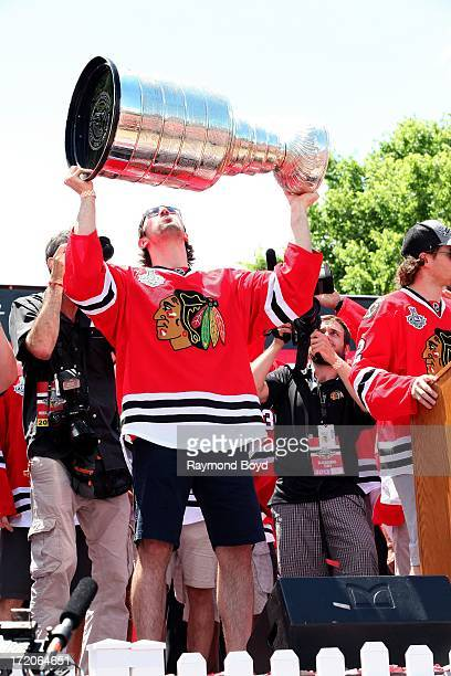 Nick Leddy defenseman for the Chicago Blackhawks raises the Stanley Cup Trophy during the Chicago Blackhawks' 2013 Stanley Cup Championship rally at...