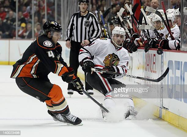 Nick Leddy of the Chicago Blackhawks dumps the puck past Cam Fowler of the Anaheim Ducks in the second period at Honda Center on February 26 2012 in...