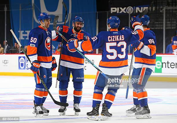 Nick Leddy of the New York Islanders celebrates his first period goal against the Florida Panthers with teammates Adam Pelech Casey Cizikas and...