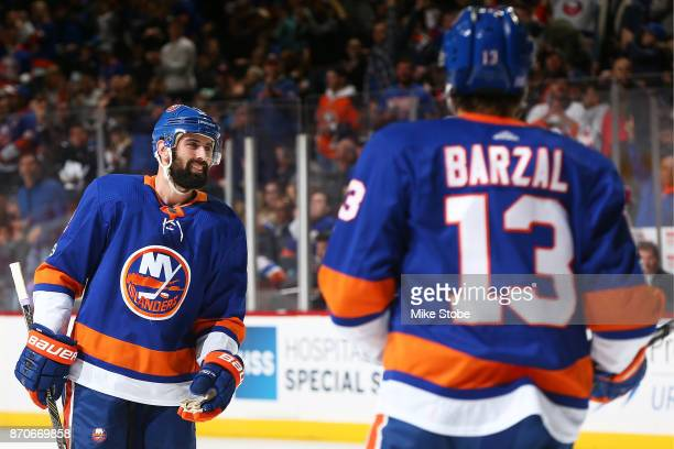 Nick Leddy of the New York Islanders celebrates his second goal of the game against Colorado Avalanche with teammates Mathew Barzal at Barclays...