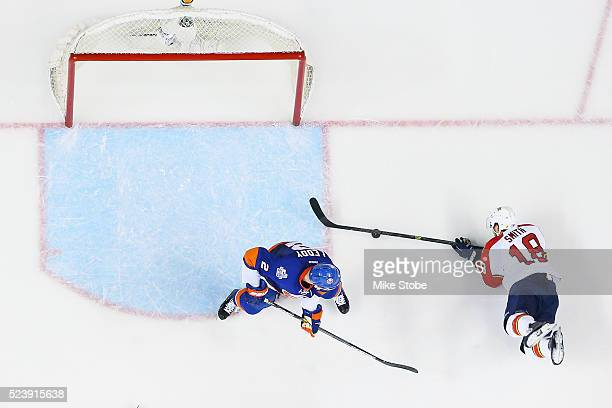 Nick Leddy of the New York Islanders defends the net against Reilly Smith of the Florida Panthers in Game Six of the Eastern Conference First Round...