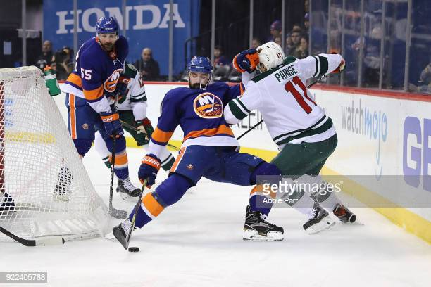 Nick Leddy of the New York Islanders fights for the puck against Zach Parise of the Minnesota Wild in the first period during their game at Barclays...