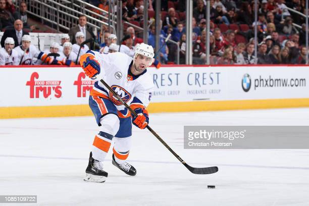Nick Leddy of the New York Islanders handles the puck during the NHL game against the Arizona Coyotes at Gila River Arena on December 18 2018 in...