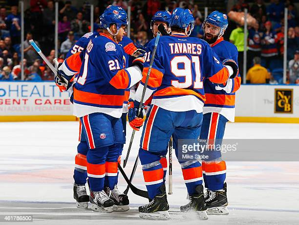 Nick Leddy of the New York Islanders is congratulated by his teammates after scoring a third period goal against the Philadelphia Flyers at Nassau...