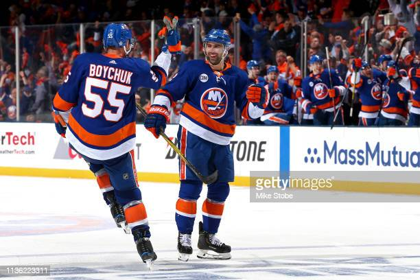 Nick Leddy of the New York Islanders is congratulated by his teammate Johnny Boychuk after scoring a third period goal against the Pittsburgh...