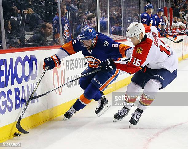 Nick Leddy of the New York Islanders moves the puck around Aleksander Barkov of the Florida Panthers during the second period at the Barclays Center...