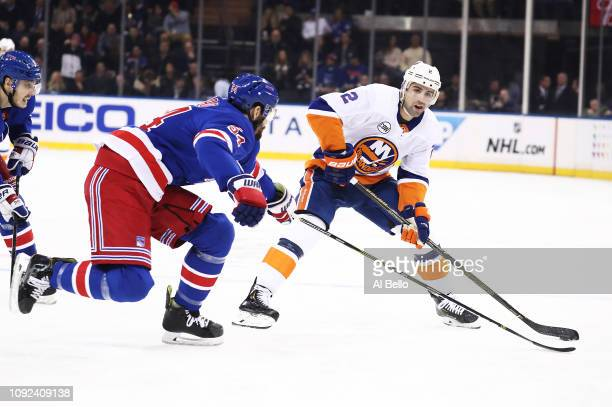 Nick Leddy of the New York Islanders skates against Adam McQuaid of the New York Rangers during their game at Madison Square Garden on January 10...