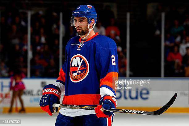 Nick Leddy of the New York Islanders skates against the Toronto Maple Leafs at Nassau Veterans Memorial Coliseum on October 21 2014 in Uniondale New...