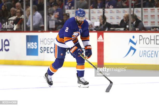 Nick Leddy of the New York Islanders skates with the puck against the Calgary Flames in the first period during their game at Barclays Center on...
