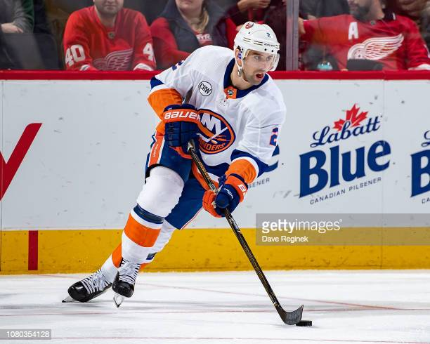 Nick Leddy of the New York Islanders turns up ice with the puck against the Detroit Red Wings during an NHL game at Little Caesars Arena on December...