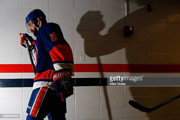 Nick Leddy of the New York Islanders walks out to the ice for warmups prior to a game against the Columbus Blue Jackets at Nassau Veterans Memorial...