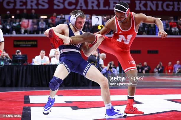 Nick Lee of the Penn State Nittany Lions wrestles Chad Red Jr. Of the Nebraska Cornhuskers during the semi final round of the Big Ten Championships...