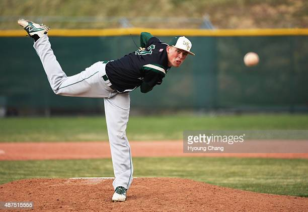 Nick Leonard of Mountain Vista High School is pitching against Regis Jesuit High School at Regis Jesuit High School Aurora Colorado April 30 2014...