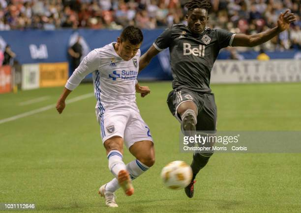 Nick Lima of the San Jose Earthquakes and Alphonso Davies of the Vancouver Whitecaps at BC Place on September 1 2018 in Vancouver Canada