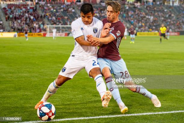 Nick Lima of the San Jose Earthquakes and Sam Nicholson of the Colorado Rapids challenge for the ball during the first half at Dick's Sporting Goods...