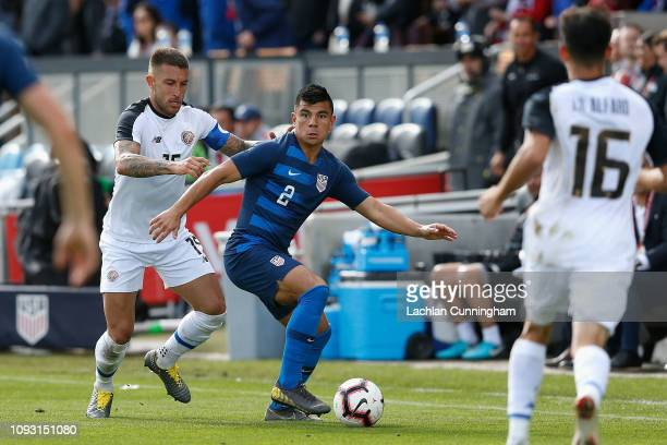 Nick Lima of the United States gets by Francisco Calvo of Costa Rica during their international friendly match at Avaya Stadium on February 2 2019 in...