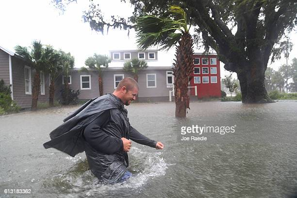 Nick Lomasney walks through heavy wind and a flooded street as Hurricane Matthew passes through the area on October 7 2016 in St Augustine Florida...