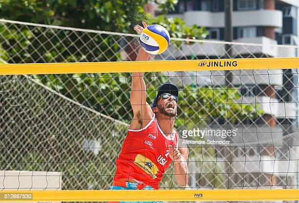 Nick Lucena of the Unitdes States spikes the ball during the main draw match against italy at Pajucara beach during day five of the FIVB Beach...