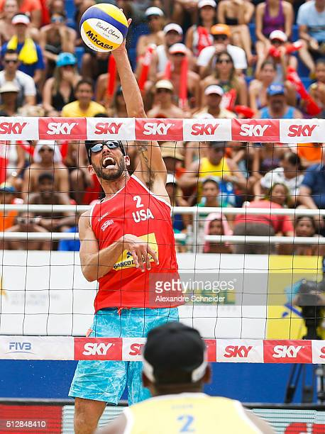 Nick Lucena of the United States spikes the balll during the golden medal match agains Brazil at Pajucara beach during day six of the FIVB Beach...
