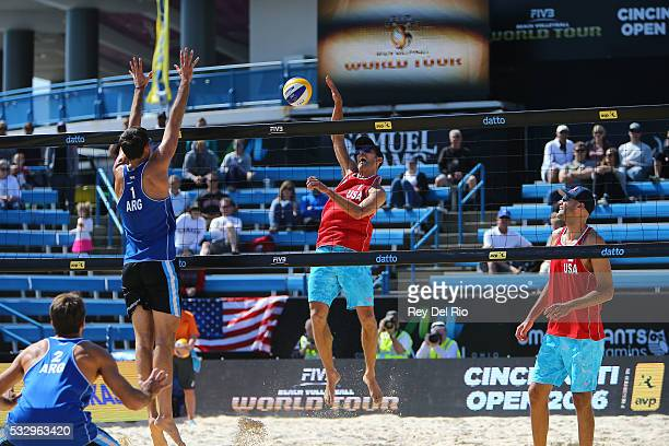 Nick Lucena of the USA hits the ball over the net against Ian Mehamed of Argentina during day 3 of the 2016 AVP Cincinnati Open on May 19 2016 at the...