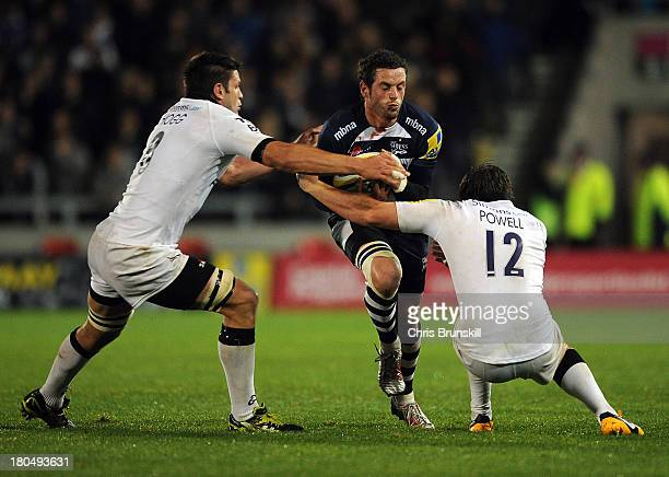 Nick Macleod of Sale Sharks is tackled by Ally Hogg and Adam Powell of Newcastle Falcons during the Aviva Premiership match between Sale Sharks and...