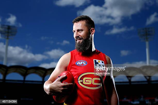 Nick Malceski poses during a Gold Coast Suns AFL portrait session at Metricon Stadium on October 13 2014 in Gold Coast Australia